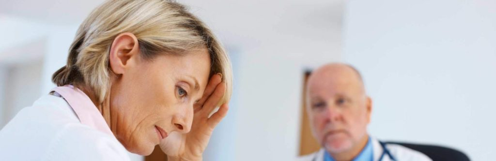 woman at doctor office receiving bad news