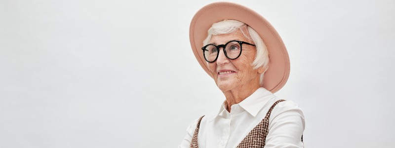 elderly woman with glasses and hat